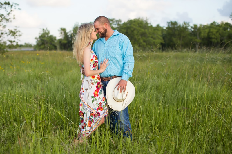 Family Photography - Woman and man draw close to each other in green field